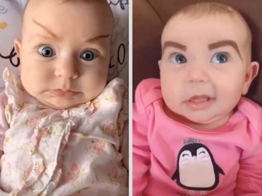 Младенец с нарисованными бровями